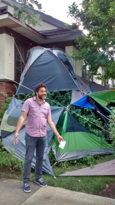 Robert Burnier in front of his Every home is a Temporary Home on 700 Block of Highland Ave Oak Park